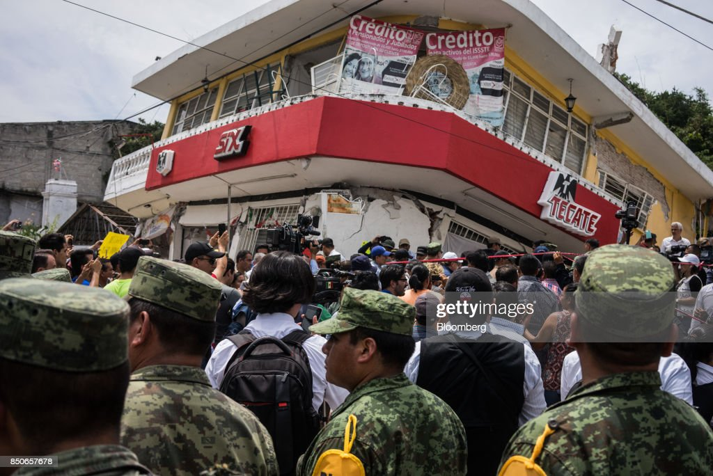 Members of the media and residents gather around Enrique Pena Nieto, Mexico's president, not pictured, during a tour to survey the damage from a 7.1 magnitude earthquake in the town of Jojutla de Juarez, Morelos State, Mexico, on Wednesday, Sept. 20, 2017. At least 225 have been killed following a 7.1 magnitude earthquake that struck near Mexico City Tuesday. It came just hours after annual safety drills were held on the anniversary of a 1985 earthquake that killed 5,000. Photographer: Cesar Rodriguez/Bloomberg via Getty Images