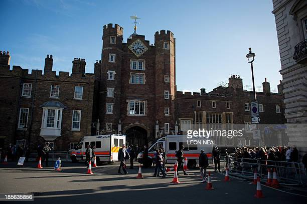 Members of the media and Royal supporters wait opposite St James's Palace in central London on October 23 as Prince George of Cambridge is baptised...