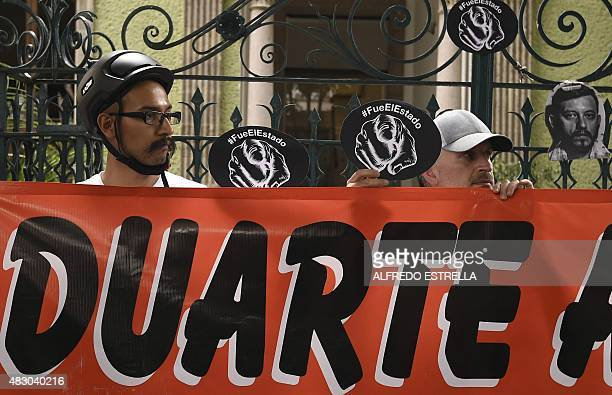 Members of the media and the civil society protest with banners against Veracruz governor Javier Duarte, demanding justice in the murder of...
