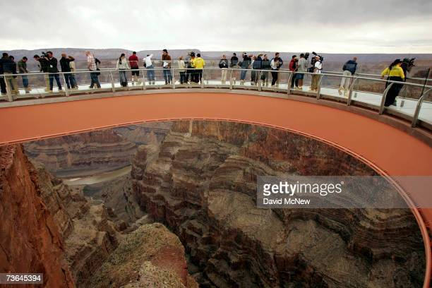 Members of the media and the Hualapai tribe take a preview walk on the Skywalk billed as the firstever cantilevershaped glass walkway extending 70...