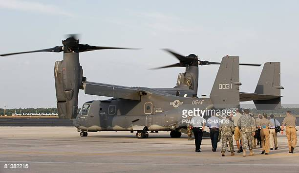 Members of the media and the military step onto a US Air Force CV22 Osprey tiltrotor aircraft for a flight as it sits on the tarmac at MacDill AFB in...