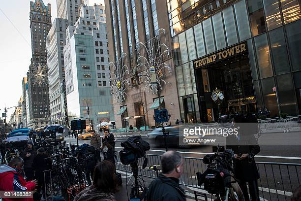 Members of the media are assembled for live television broadcasts outside of Trump Tower January 11 2017 in New York City On Wednesday morning...