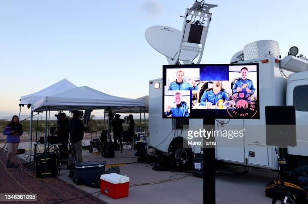 Members of the media are gathered before Blue Origin's New Shepard lifts-off from the launch pad carrying 90-year-old Star Trek actor William Shatner...