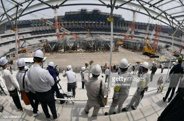 Members of the media are given a tour of Japan's new National Stadium the main venue of the 2020 Tokyo Olympics and Paralympics under construction on...