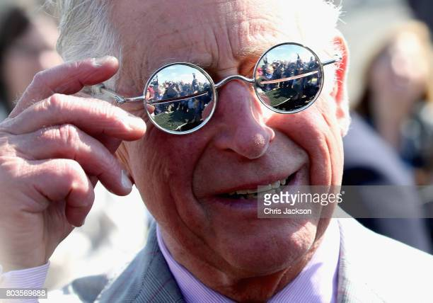 Members of the media are reflected in some snow glasses as Prince Charles, Prince of Wales attends a community feast event at Sylvia Grinnel...