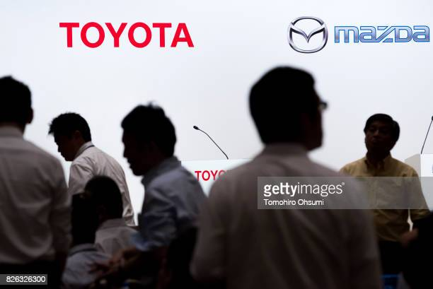 Members of the media are seen in front of Toyota Motor Co and Mazda Motor Co logos during a joint press conference with on August 4 2017 in Tokyo...