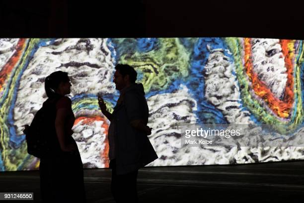 Members of the media are seen viewing 'Where Shapes Come From' by artists Semiconductor which is part of the 31st Biennale of Sydney at Carriage...