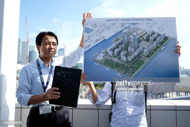 Members of the media are shown an artists impression of the finished Athletes Olympic village during the First World Press Briefing for the Tokyo...