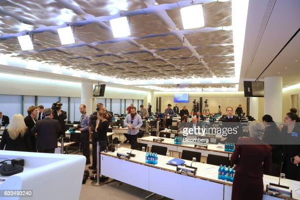 Members of the media arrive in a press room ahead of the Deutsche Bank AG earnings news conference in Frankfurt Germany on Thursday Feb 2 2017...