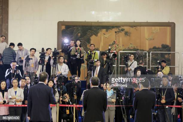 Members of the media assemble before the opening of the 19th National Congress of the Communist Party of China in Beijing, China, on Wednesday, Oct....