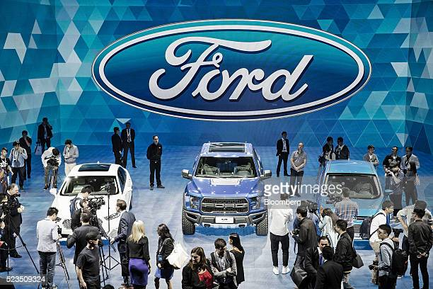 Members of the media attend a Ford Motor Co Media Night event ahead of the Beijing International Automotive Exhibition in Beijing China on Saturday...