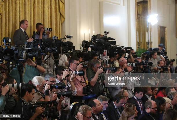 Members of the media attend a news conference with US President Donald Trump and Prime Minister of Italy Giuseppe Conte in the East Room of the White...