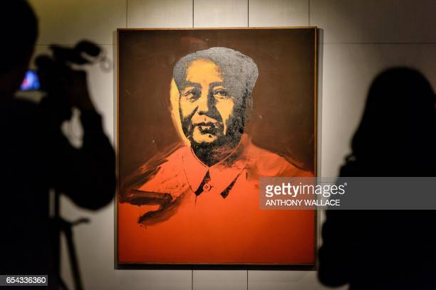 Members of the media attend a preauction preview of Mao by US artist Andy Warhol acrylic and silkscreen ink on canvas at a Sotheby's showroom in Hong...