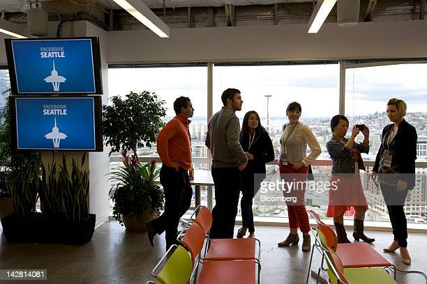 Members of the media attend a press event at Facebook Inc's new offices in Seattle Washington US on Thursday April 12 2012 Facebook Inc the world's...