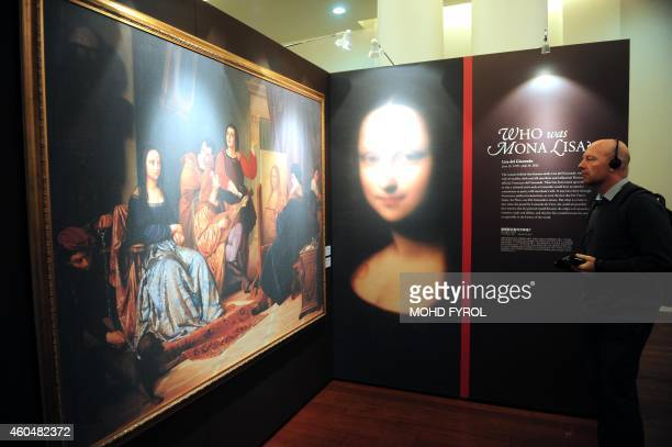 Members of the media attend the media preview of The World Premiere of Leonardo Da Vinci's painting 'Earlier Mona Lisa' exhibition in Singapore on...