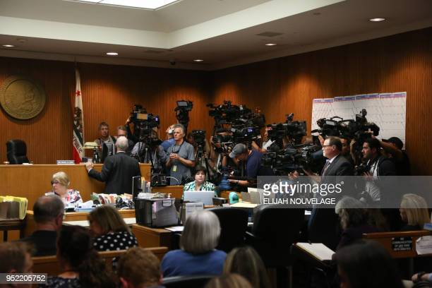 Members of the media await the arrival of Joseph James DeAngelo for his arraignment on two charges of murder April 27 2018 in Sacramento California...