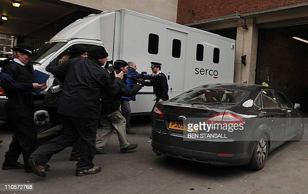 Members of the media chase the unmarked police car carrying the founder of Wikileaks Julian Assange as it arrives at Westminster Magistraites Court...