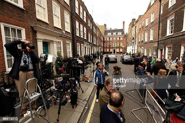 Members of the media congregate in Cowley Street outside the Liberal Democrat Headquarters to wait for the departure of Liberal Democrat leader Nick...