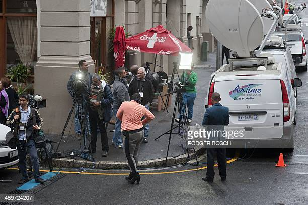 Members of the media congregate outside the Western Cape High court where British murder accused Shrien Dewani's pretrial hearing was taking place on...