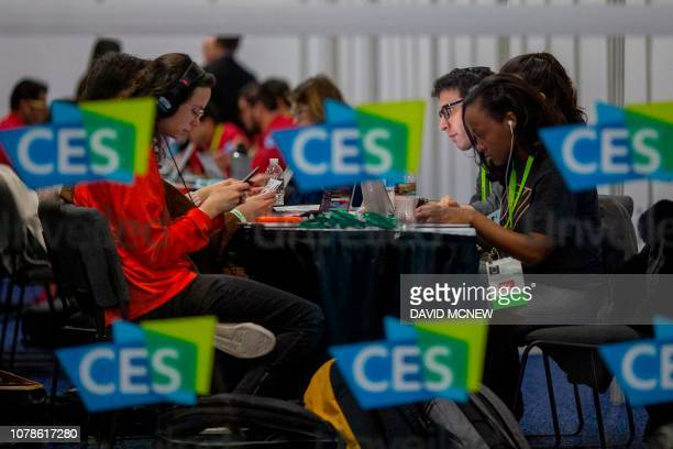Members of the media cover the CES Unveiled Las Vegas event in advance of CES in Las VegasNevada January 6 2019