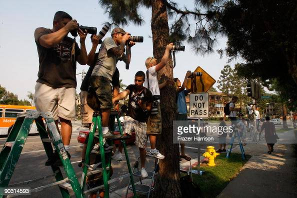 Members of the media cover the funeral of Adam Goldstein