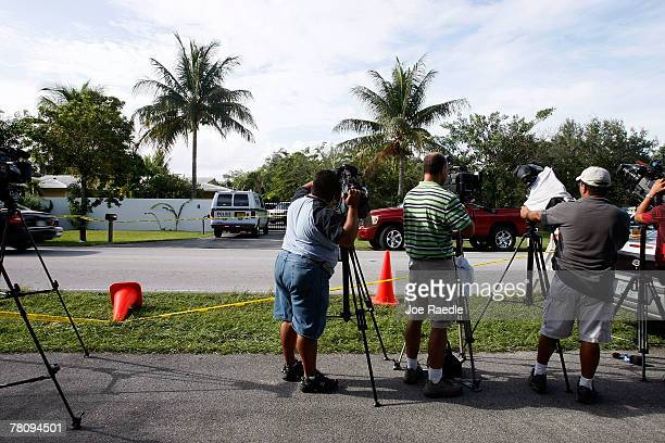 Members of the media cover the scene in front of the home where an intruder shot Washington Redskins football player Sean Taylor in the leg November...