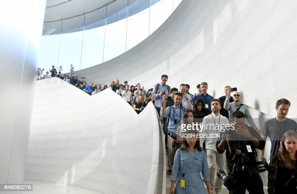 Members of the media enter the Steve Jobs Theater at Apple's new headquarters ahead of a media event where Apple is expected to announce a new iPhone...