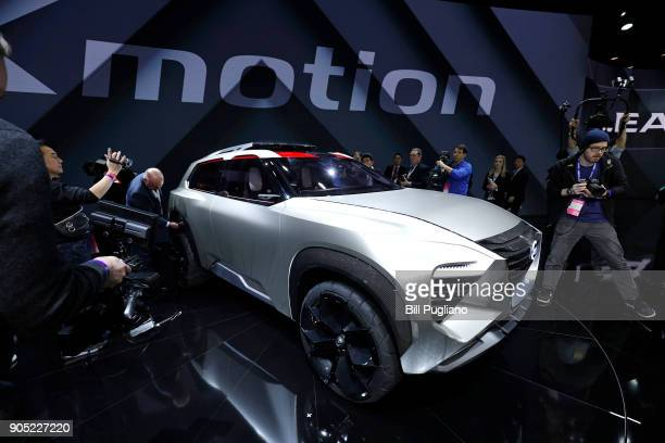 Members of the media examine the new Nissan Xmotion crossover concept vehicle after its debut at the 2018 North American International Auto Show...