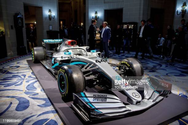 Members of the media film and photograph the newly unveiled livery of the Mercedes AMG Petronas F1 Team's 2020 race car for the upcoming 2020 season,...