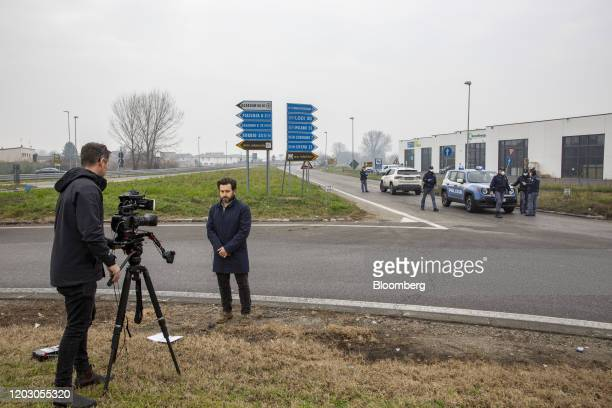 Members of the media film at a yellow zone quarantine roadblock near the quarantine red zone in the town of Codogno in Guardamiglio Italy on Tuesday...