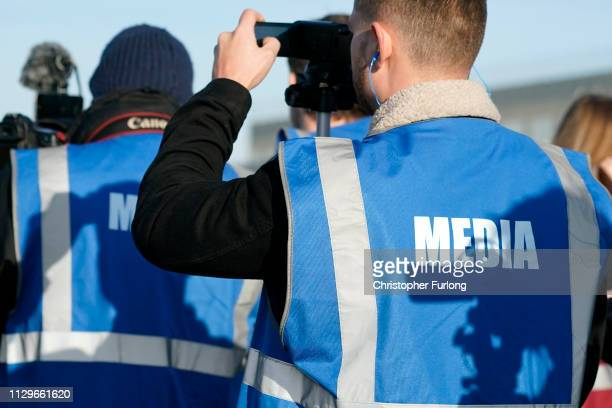 Members of the media film the new Airbus Beluga XL as it comes in to land at the Broughton wing assembly plant of Airbus on February 14 2019 in...