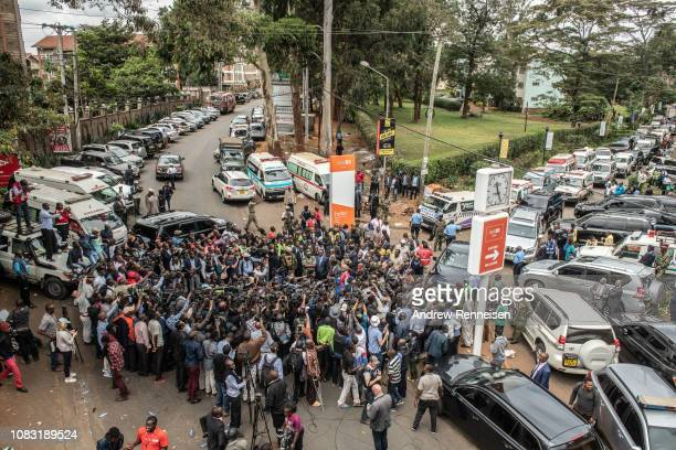 Members of the media gather around Interior Cabinet Secretary Fred Matiang'i during a press conference outside of the Dusit Hotel on January 16 2018...