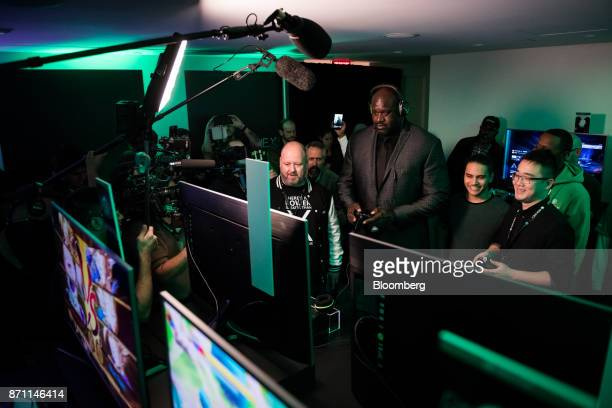 Members of the media gather as former National Basketball Association player Shaquille O'neal center demos a game on the Xbox Developer Kit version...