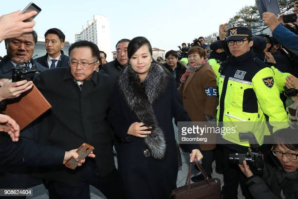 Members of the media gather as HyonSongWol a North Korean pop star party member and head of an advance team for North Koreas art troupe center...