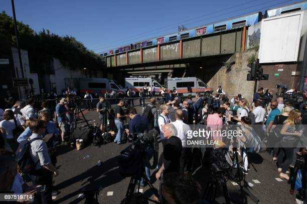 Members of the media gather at a Police near the scene in Finsbury Park area of north London after a vehicle hit pedestrians on June 19 2017 All the...