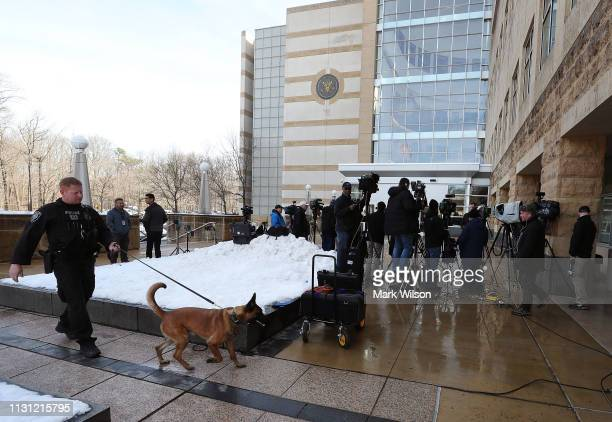 Members of the media gather at the United States District Court Greenbelt Division on February 21 2019 in Greenbelt Maryland A member of the US Coast...