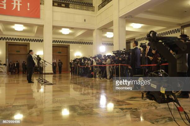 Members of the media gather for a briefing at the Great Hall of the People during the 19th National Congress of the Communist Party of China in...