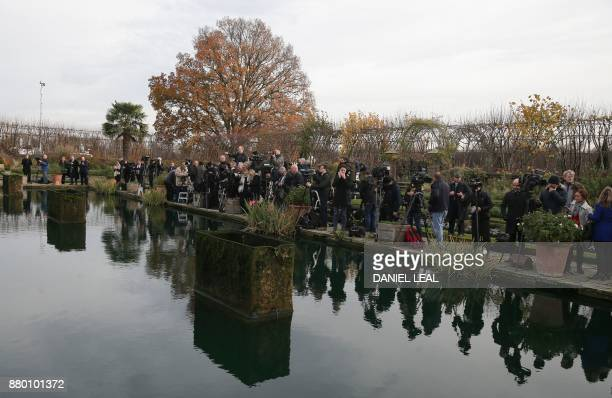Members of the media gather in the Sunken Garden at Kensington Palace in west London on November 27 as they wait for Britain's Prince Harry and his...