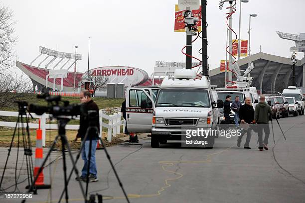 Members of the media gather near Arrowhead Stadium as they report on the death of Jovan Belcher of the Kansas City Chiefs on December 1 2012 in...