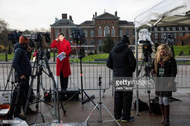 Members of the media gather outside Kensington Palace on November 27 2017 in London England Prince Harry and Meghan Markle's engagement was announced...