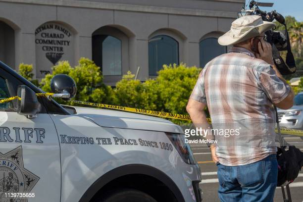 Members of the media gather outside the Congregation Chabad synagogue on April 27, 2019 in Poway, California. A gunman opened fire at the synagogue...