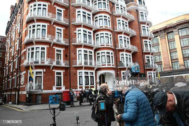 Members of the media gather outside the Ecuadorian Embassy following the arrest of Wikileaks founder, Julian Assange on April 11, 2019 in London,...