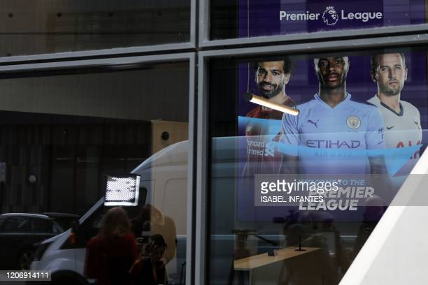 Members of the media gather outside the headquarters of the English Premier League in London on March 13 prior to an emergency meeting over the...