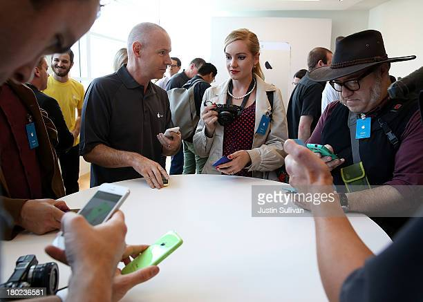 Members of the media inspect the new iPhone 5C during an Apple product announcement at the Apple campus on September 10 2013 in Cupertino California...