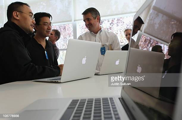 Members of the media look at a display of the new Mac Book Air during an Apple special event at the company's headquarters on October 20 2010 in...