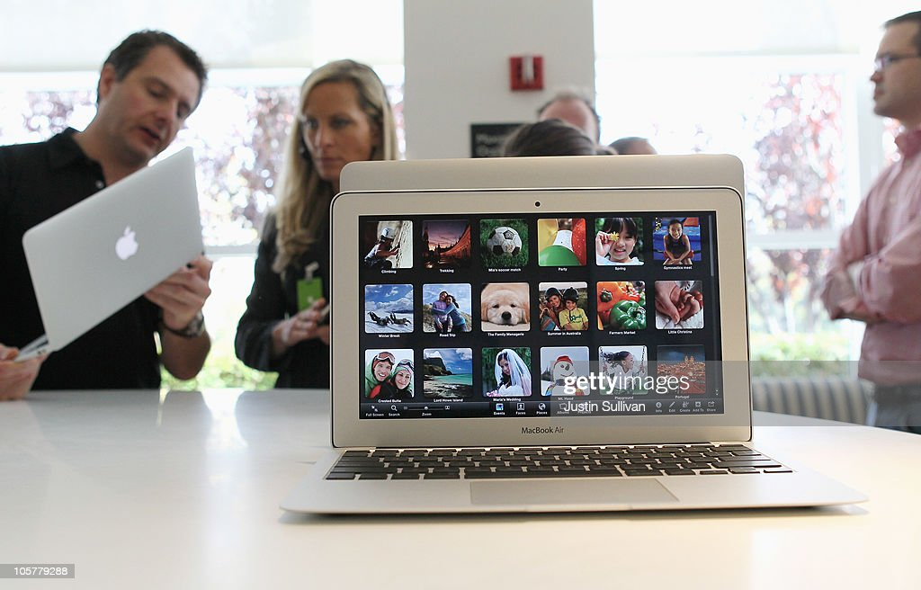 Members of the media look at a display of the new Mac Book Air during an Apple special event at the company's headquarters on October 20, 2010 in Cupertino, California. Apple CEO Steve Jobs announced the new MacBook Air in eleven and thirteen inch models starting at $999. He also announced the OSX Lion operating system for Mac computers.