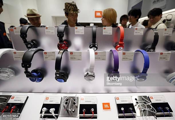 Members of the media look at Harman International Industries Inc's JBL branded overear headphones displayed at the Harman store in Tokyo Japan on...