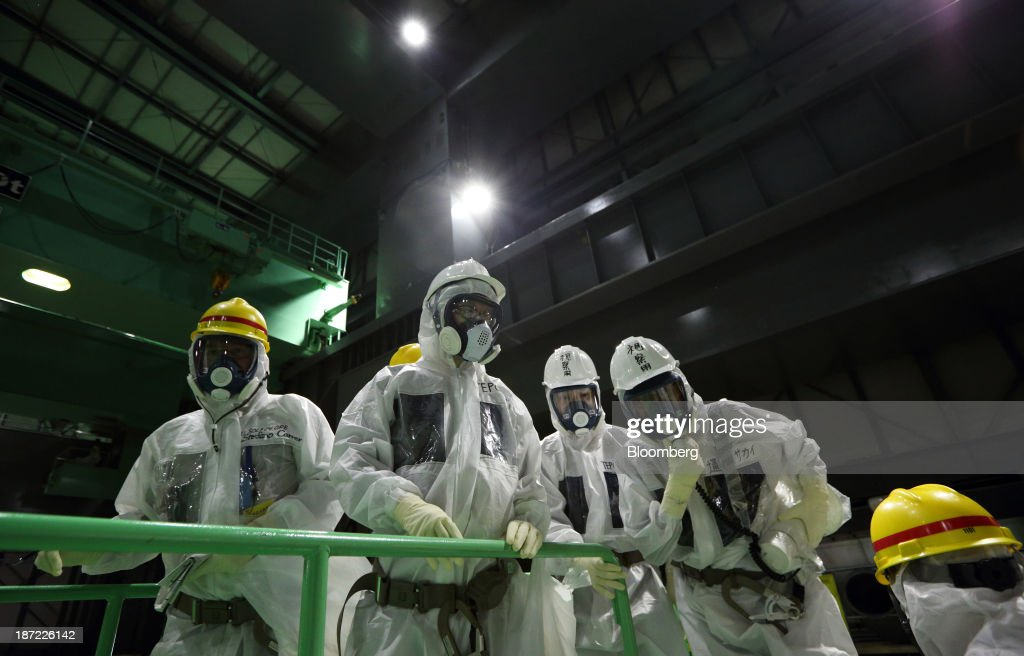Members of the media look at the spent fuel pool from a fuel handling machine inside the building housing the No. 4 reactor at Tokyo Electric Power Co.'s (Tepco) Fukushima Dai-ichi nuclear power plant in Okuma, Fukushima Prefecture, Japan, on Thursday, Nov. 7, 2013. Tepco, which returned to profitability in its first-half earnings report on Oct. 31, is handling an estimated 11 trillion yen ($112 billion) cleanup of the nuclear plant wrecked by an earthquake and tsunami in 2011. Photographer: Tomohiro Ohsumi/Bloomberg via Getty Images