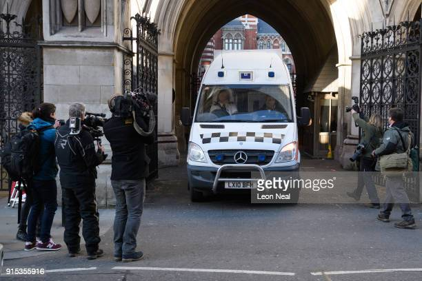 Members of the media look on as a prison van carries convicted rapist John Worboys from the High Court on February 7 2018 in London England A...