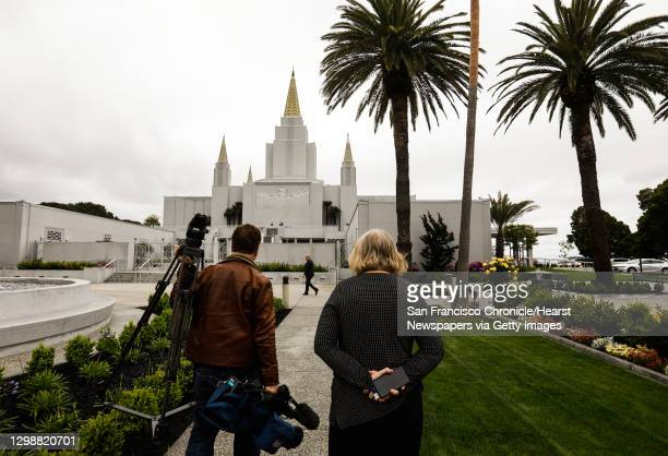 Members of the media make their way towards the Mormon Temple for a tour in Oakland, California, on Monday, May 6, 2019. The interior recently...